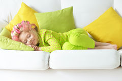 Girl in hair curlers sleeping in her bed Stock Photos