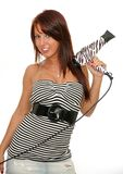 Girl with hair dryer. Picture of the beautiful young woman holding hair dryer Stock Image