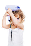 Girl with a hair dryer Stock Photography