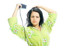 Girl with hair-dryer Stock Photography