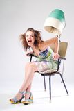 Girl and Hair Dryer. Expressive pretty girl in dress with hair dryer stock image