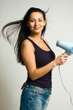 The girl with the hair dryer Stock Photos