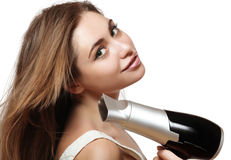 Girl with hair dryer Royalty Free Stock Image