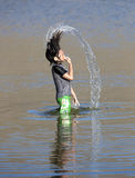 Girl hair flips with water. Royalty Free Stock Photo
