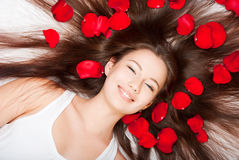 Girl with hair and fluff Royalty Free Stock Image
