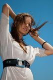 Girl with hair fluttering in the wind Stock Photo