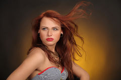 Girl with hair fluttering in the wind Royalty Free Stock Image
