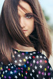 Girl with hair fluttering Royalty Free Stock Photography