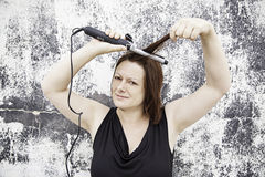 Girl hair irons Royalty Free Stock Photo