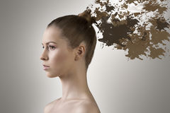 Girl with hair melting in paint Stock Photos