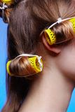 Girl with hair rollers Royalty Free Stock Images