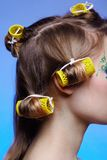 Girl with hair rollers Stock Photo