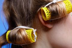 Girl with hair rollers Royalty Free Stock Photo