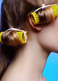 Girl with hair rollers Stock Image