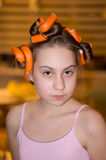 Girl in hair rollers. The girl clocked curlers and posing Royalty Free Stock Images