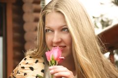 Girl hair rose. Female young stock photography