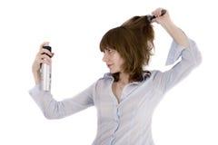 Girl with the hair spray Stock Photography