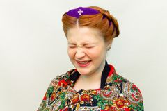 Girl with a hair style in a Slavic style laughs royalty free stock photos