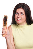 Girl with hairbrush Royalty Free Stock Photo