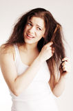 Girl with hairbrush, hair problems Royalty Free Stock Photo