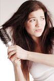 Girl with hairbrush, hair problems Stock Image