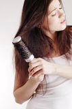 Girl with hairbrush, hair problems Royalty Free Stock Photography