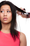 Girl hairdo with electric hair curler Royalty Free Stock Photography