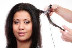 Girl hairdo with electric hair curler Stock Photos