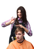 Girl hairdresser cutting hair of young man isolate Royalty Free Stock Photography