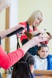 Girl in hairdresser salon Stock Images