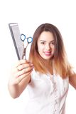 Girl hairdresser with scissors and comb Royalty Free Stock Images