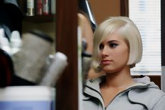 Girl at hairdressers. A young woman in professional beauty salons Stock Image