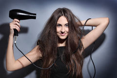 Girl with hairdryer Royalty Free Stock Photo