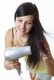 Girl with hairdryer Royalty Free Stock Image