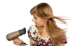 Girl with hairdryer. Isolated on white Stock Photography