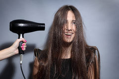 Girl with hairdryer Royalty Free Stock Photography