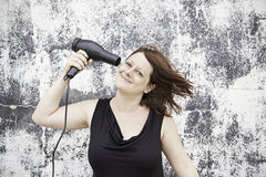 Girl with hairdryer Stock Photo