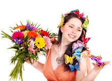 Girl in hairstyle with flower and butterfly. Stock Photos