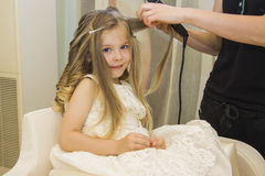 Girl hairstyle. Little girl with wet hair is being prepared to have her hair style Royalty Free Stock Photo