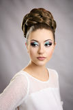 Girl with hairstyle and makeup. Beautiful studio portrait Stock Image