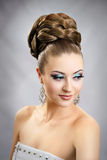 Girl with hairstyle and makeup. Beautiful studio portrait Royalty Free Stock Image