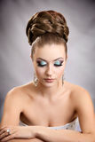 Girl with hairstyle and makeup. Beautiful studio portrait Stock Photography