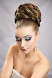 Girl with hairstyle and makeup. Beautiful studio portrait Royalty Free Stock Photo