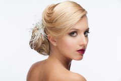 Girl with hairstyle and makeup. Portrait of a pretty young girl with a beautiful vintage hairstyle and makeup, wedding style Stock Images
