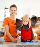 Girl in halloween bat costume spending time with mother Royalty Free Stock Photography