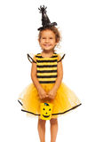 Girl in Halloween bee stripped costume Stock Image