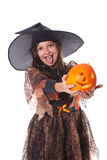 Girl in halloween costume holding a pumpkin Royalty Free Stock Photography