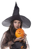 Girl on halloween costume and pumpkin Royalty Free Stock Images
