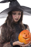 Girl on halloween costume and pumpkin Royalty Free Stock Image