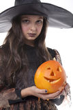 Girl on halloween costume and pumpkin Stock Photo